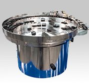 Vibratory Cap Feeder by Performance Feeders