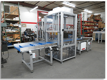 Custom Belt Conveyor System with Airlock Chamber for Moving Product Through a Cleanroom for a Medical Packaging Operation