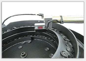 Ultra-Compact Vibratory Feeder System Orients Automotive Parts