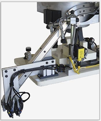 Custom Vibratory Feeder System Orients Bushings and Other Small Parts