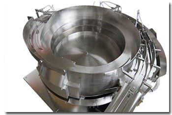 Vibratory feed systems for medical and pharmaceutical applications