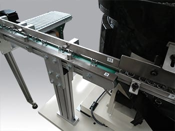 Count and Batch Packaging conveyor belt carries parts to count area.