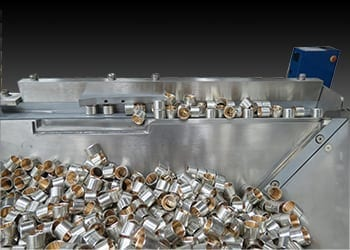 Performance Feeder's Step Feeder gently handles small or fragile cylindrical and spherical parts in automated manufacturing processes.