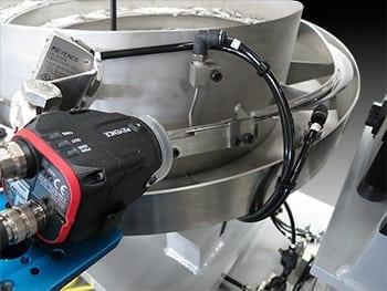 Vision System with Proximity Sensor-Triggered Camera