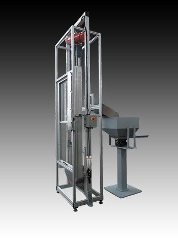 Space-saving bulk parts elevator with optional vibratory hopper.